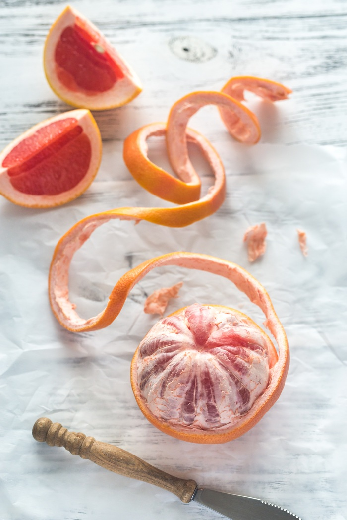 Peeled grapefruit on the table